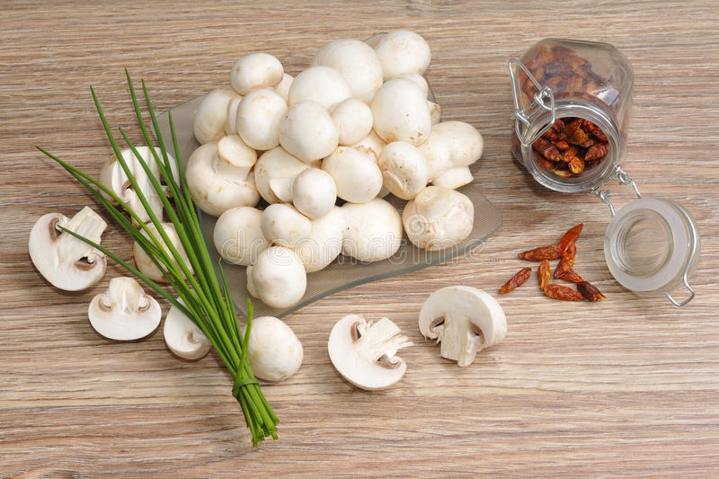 Fresh raw mushrooms. With chives royalty free stock images