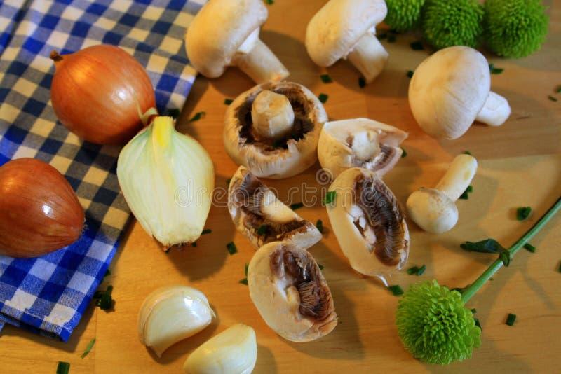 Fresh raw mushrooms on cooking board royalty free stock photo