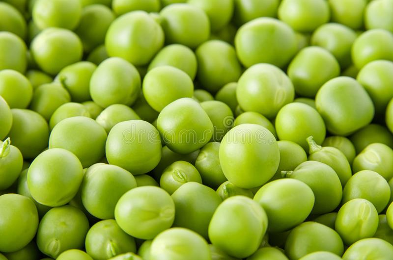 Fresh raw organic green pea background, vegetable pattern texture, selective focus. Close up stock images