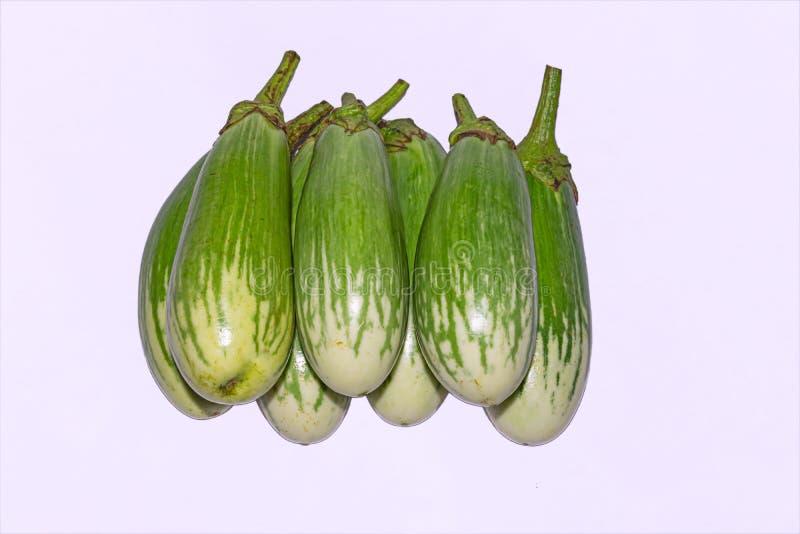 Fresh long green brinjal,thai green eggplant or aubergine on white background. Fresh,raw and organic long green brinjal,thai green eggplant or aubergine royalty free stock photo