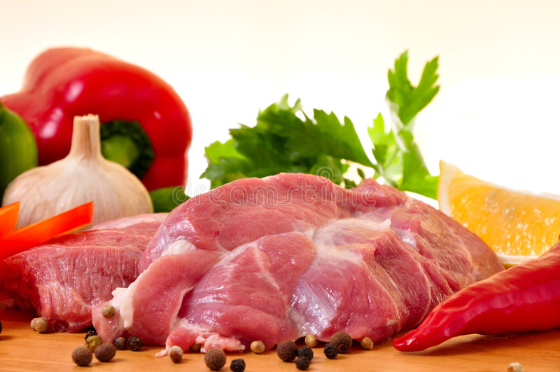 Fresh raw pork on board royalty free stock photography