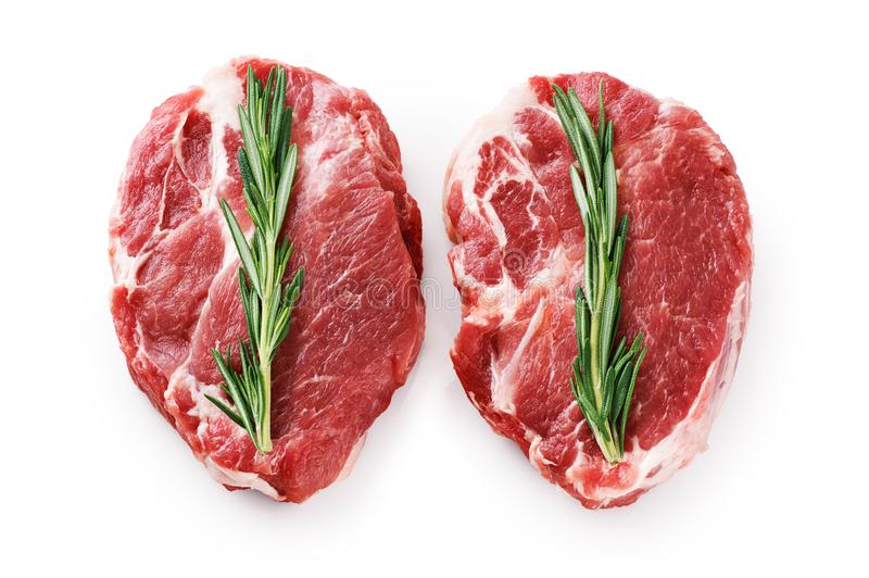 Fresh raw pork steaks and rosemary isolated on white background. stock photos
