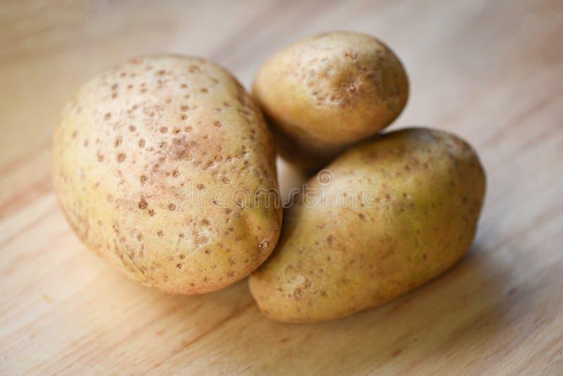 Fresh raw potato wooden backgroun. Fresh raw potato on wooden backgroun stock images