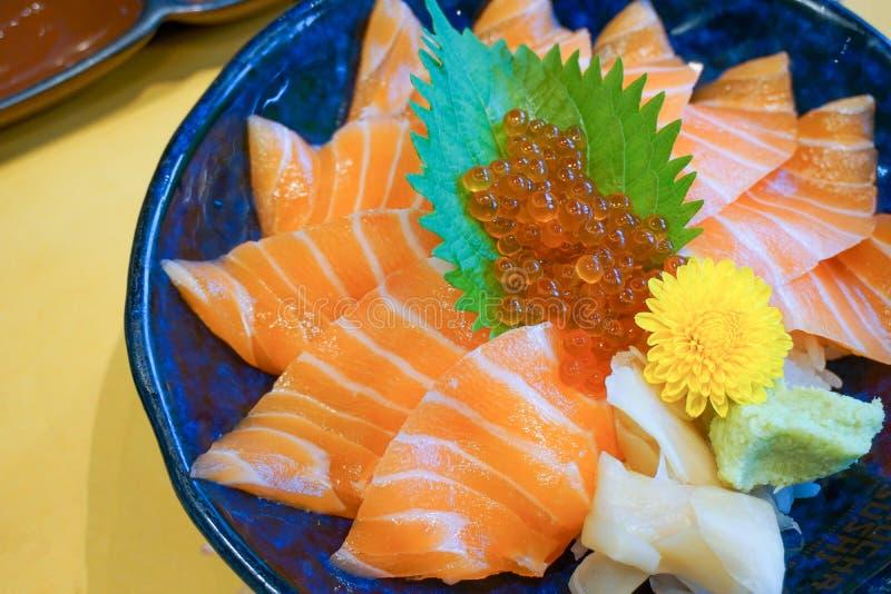 Fresh raw salmon with salmon eggs or Ikura and wasabi on topped rice bowl donburi. Japanese food style royalty free stock photo
