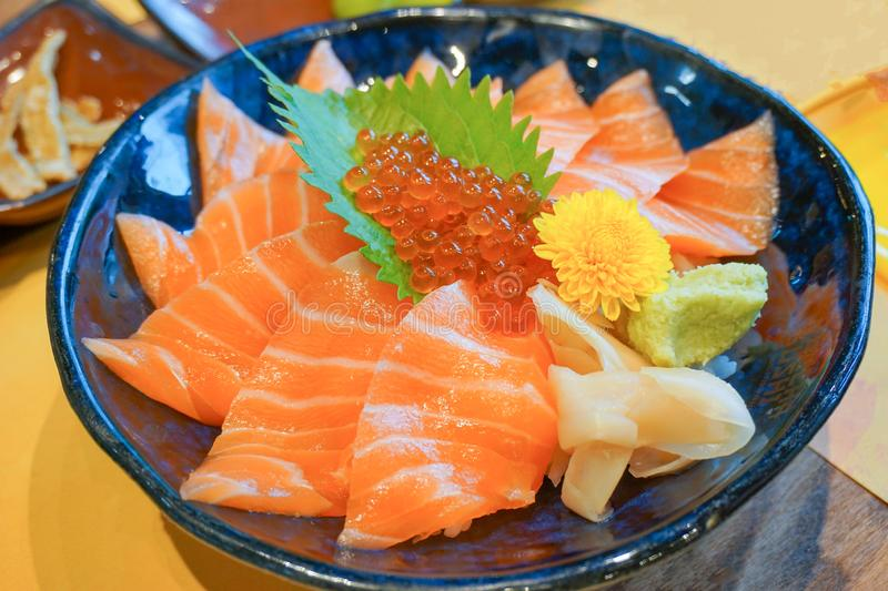 Fresh raw salmon with salmon eggs or Ikura and wasabi on topped rice bowl donburi. Japanese food style stock photography