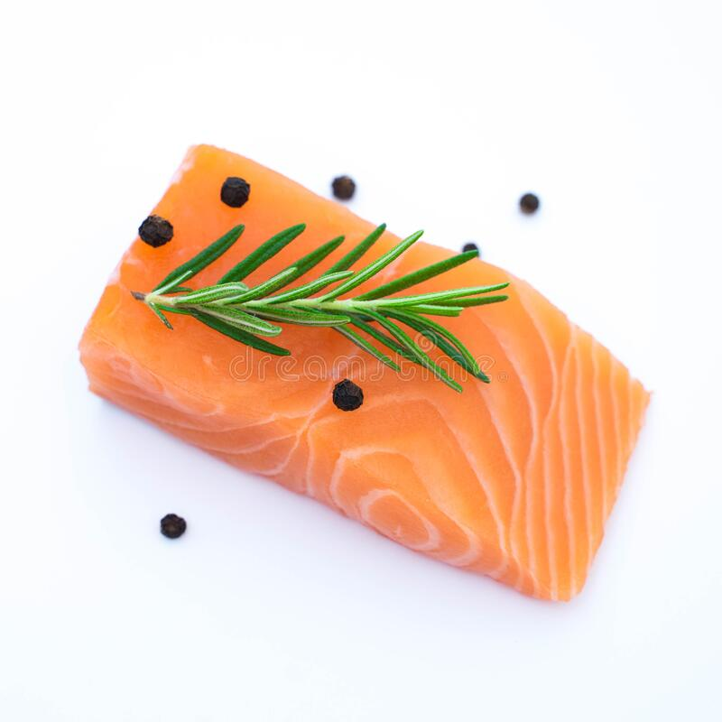 fresh raw salmon fillets isolated on white royalty free stock images