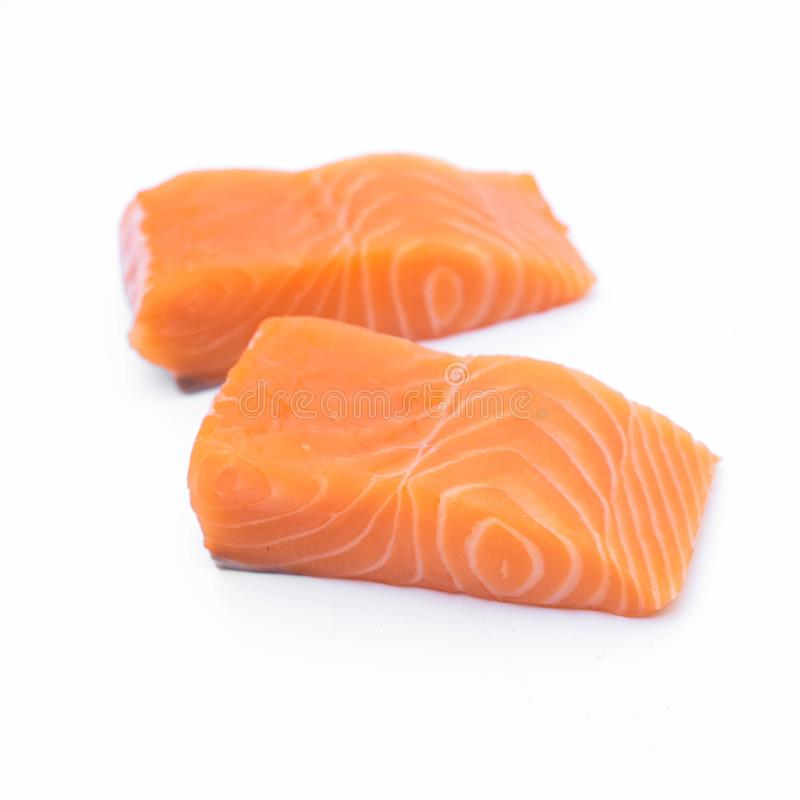 Fresh raw salmon fillets isolated on white. Background stock photography