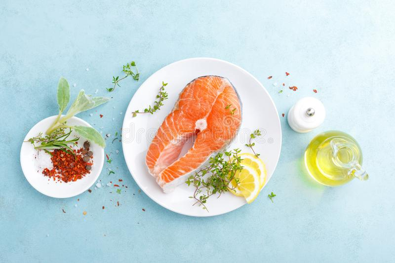 Fresh raw salmon fish steak with ingredients for cooking stock photography