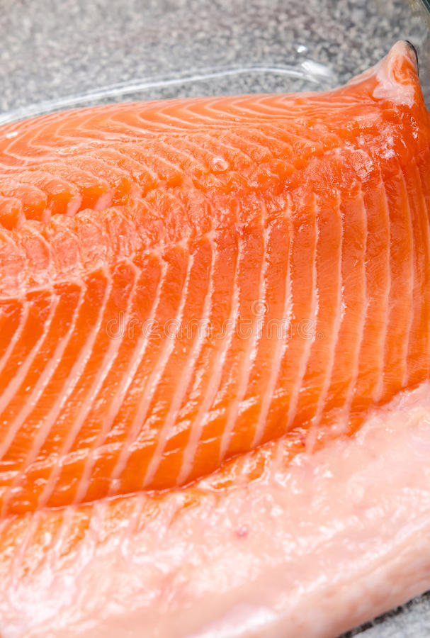 Fresh raw salmon. Large file of raw salmon in yena tray royalty free stock images