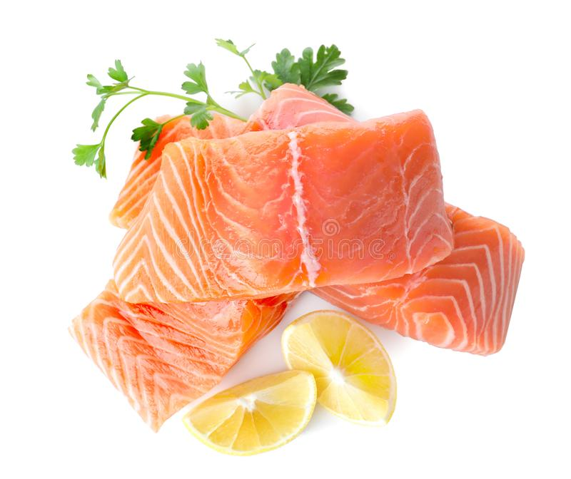 Fresh raw salmon with parsley and lemon on background, top view. Fish delicacy stock photos