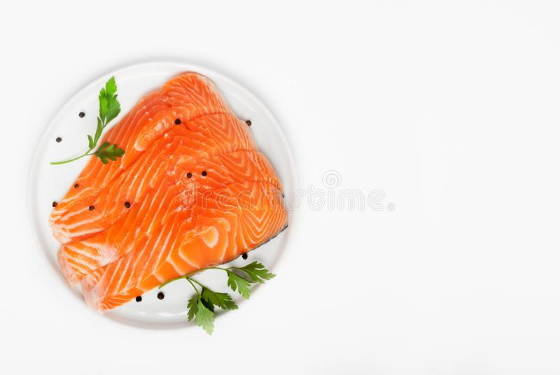 Fresh raw salmon steaks isolated on white background, top view royalty free stock photos