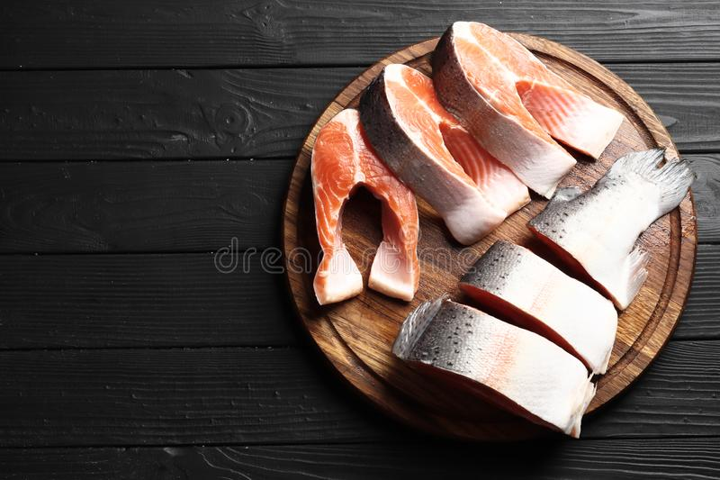 Fresh raw salmon steaks  on the rustic wooden table stock photography