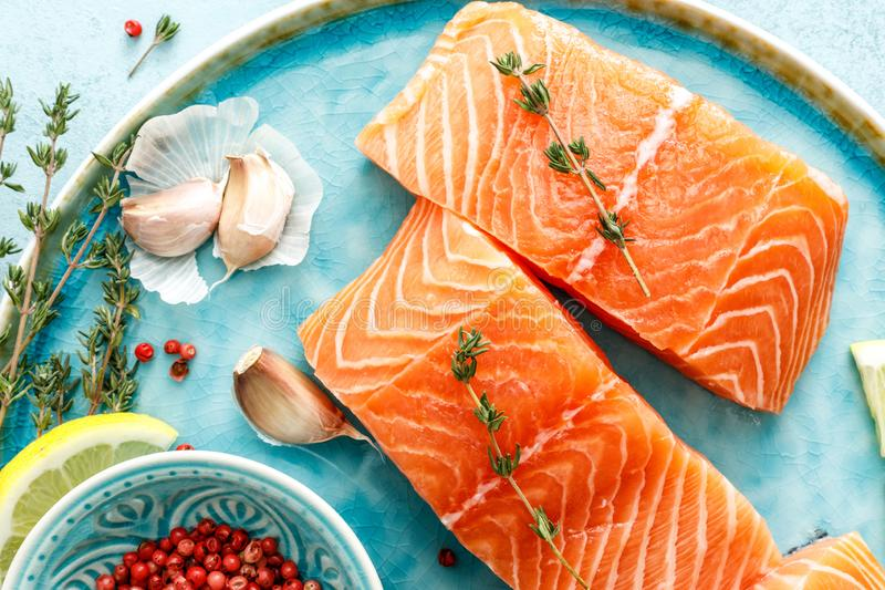 Fresh raw salmon or trout fillets with ingredients. Seafood. Fresh raw salmon or trout fillets with ingredients top view stock photo