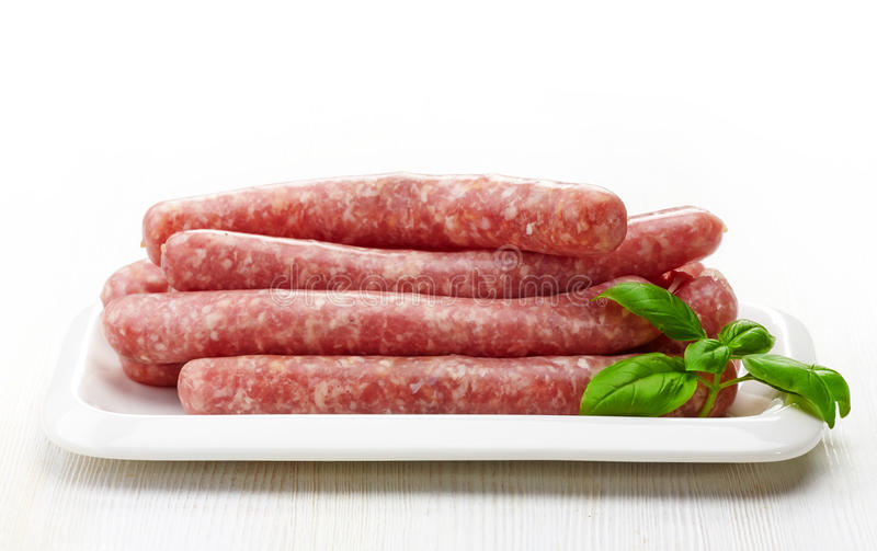 Fresh raw sausages royalty free stock photo