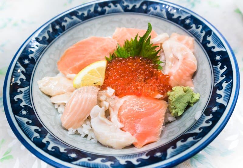 Fresh raw seafood mixed rice bowl stock photos