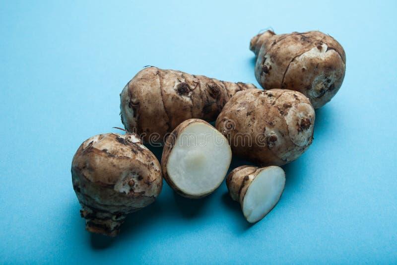 Fresh raw Topinambur or jerusalem artichoke on black background.  royalty free stock image