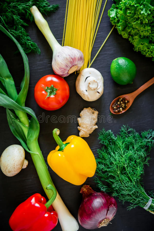 Fresh raw vegetables on a dark table. Top view. Flat lay. Healthy, diet or vegetarian food concept. royalty free stock photos