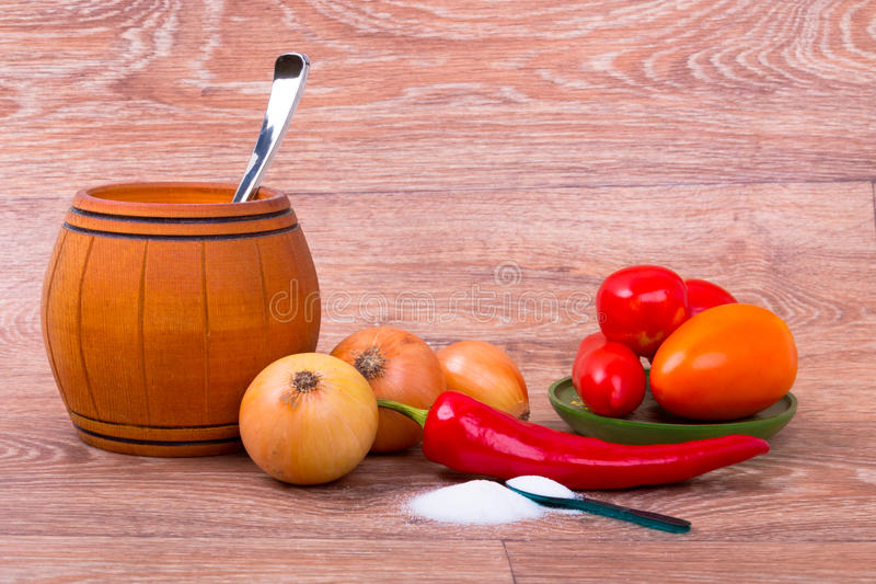 Fresh raw vegetables and small barrel with spoon on wooden background stock photos