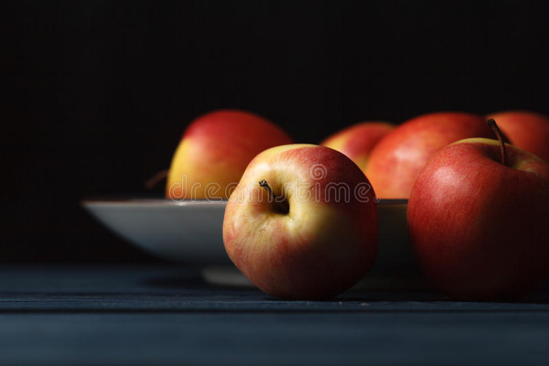 Fresh red apples on wooden blue background stock images