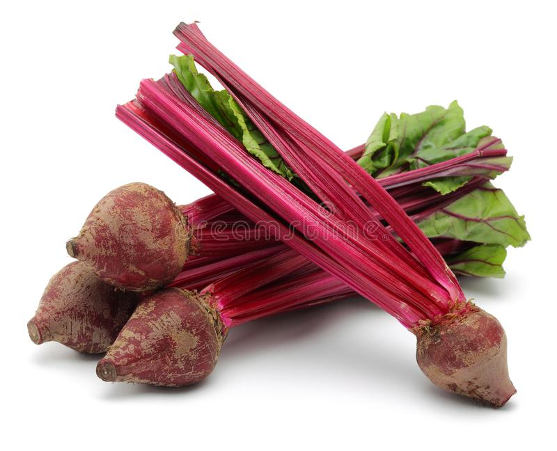 Fresh red beet roots and leaves. Isolated on white background royalty free stock photography