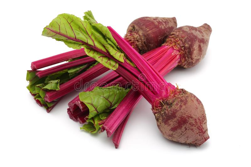 Fresh red beet roots with leaves stock photo