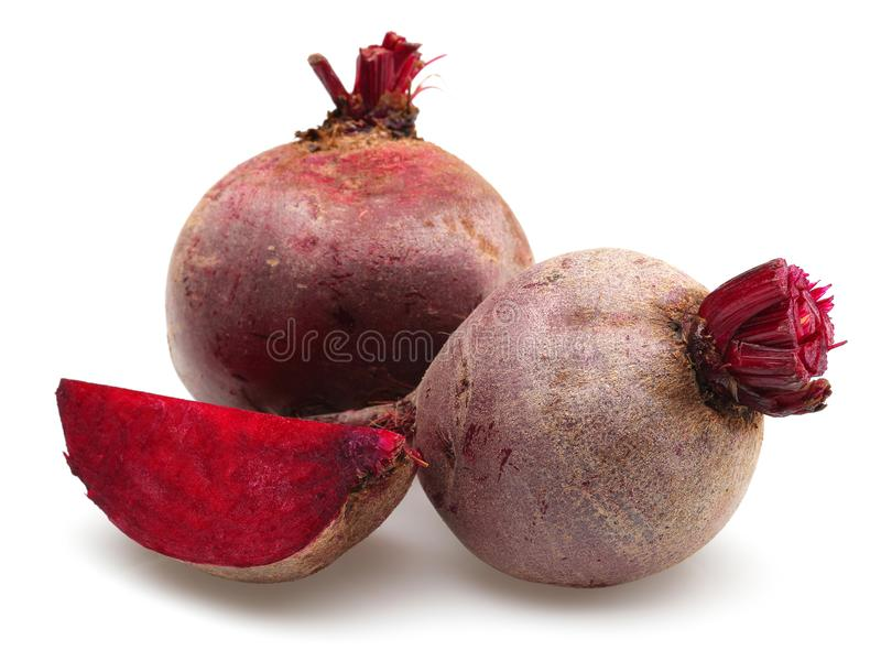 Fresh red beet roots and slice. Isolated on white background royalty free stock photo