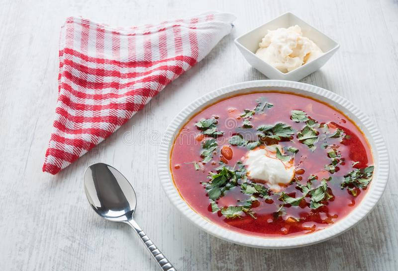 Red beet soup. The fresh red beet soup poured in a plate has been photographed in studio royalty free stock photography