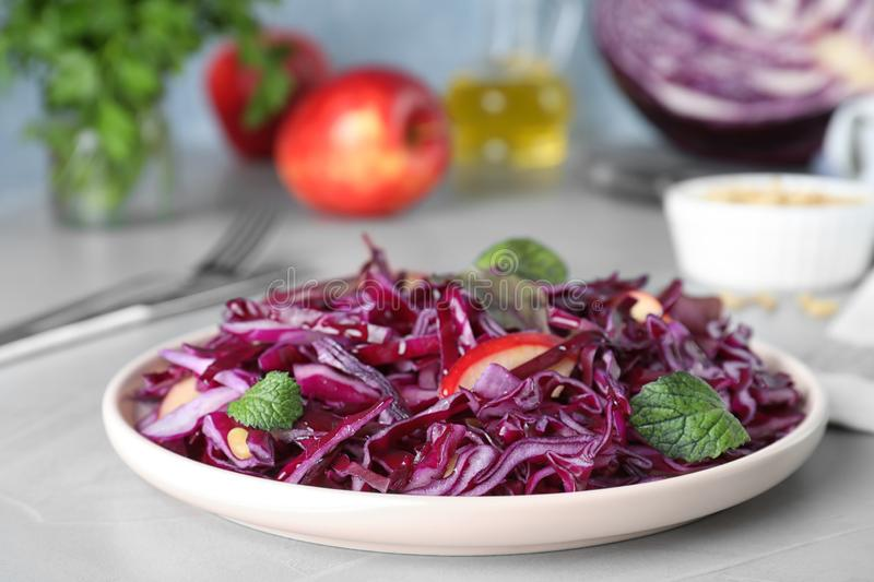 Fresh red cabbage salad served on light table. Fresh red cabbage salad served on light grey table royalty free stock photography