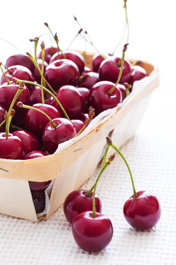 Fresh red cherries in bowl royalty free stock photography