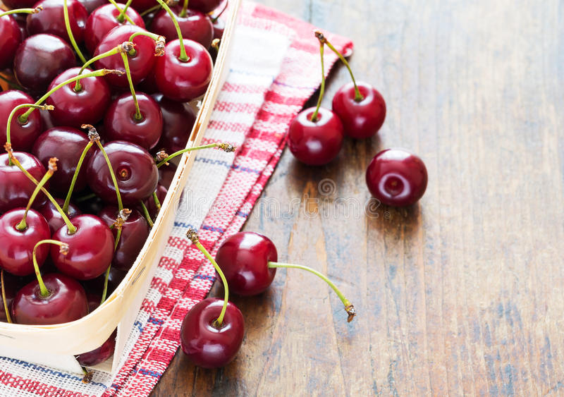 Fresh red cherries in bowl stock images