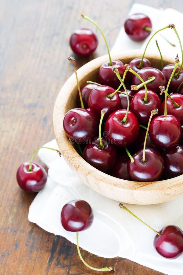 Fresh red cherries in bowl stock image