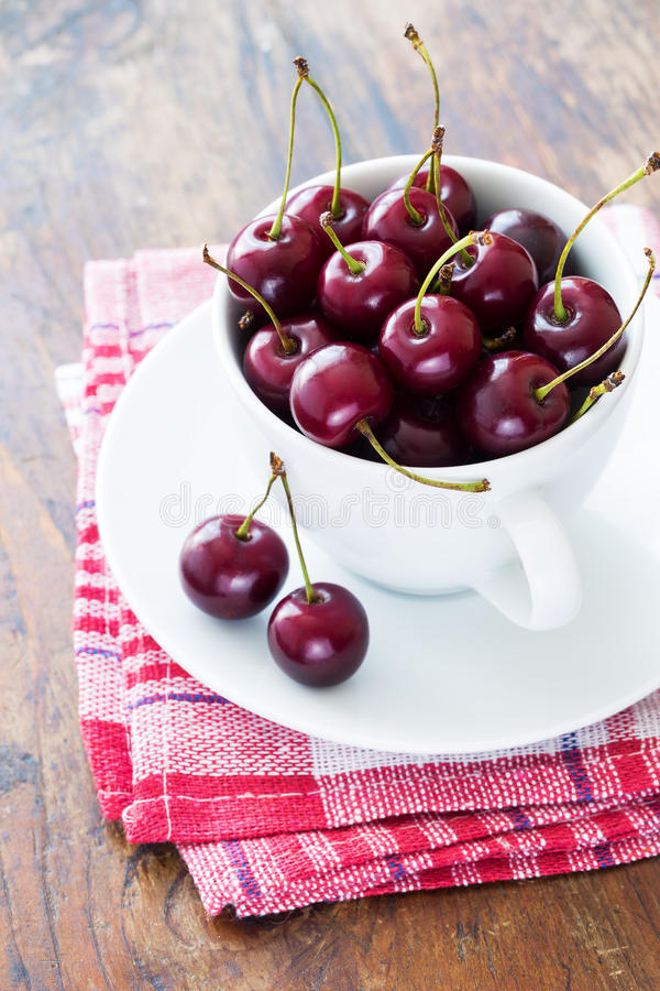 Fresh red cherries in bowl royalty free stock photo