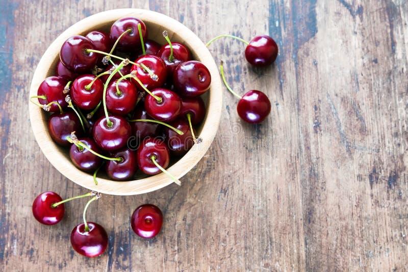 Fresh red cherries in bowl stock photos
