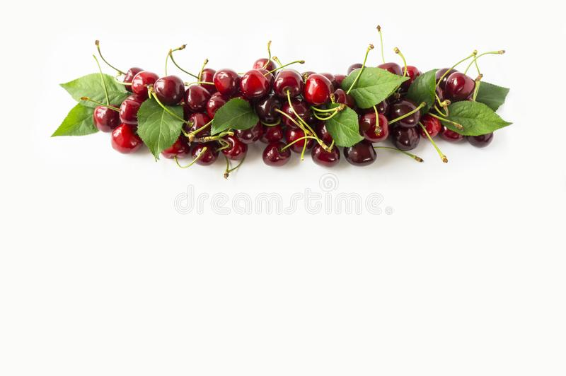 Fresh red cherries lay on white isolated background with copy space for text. Background of cherries. Ripe cherry on a white backg. Round. Cherries with copy royalty free stock photos