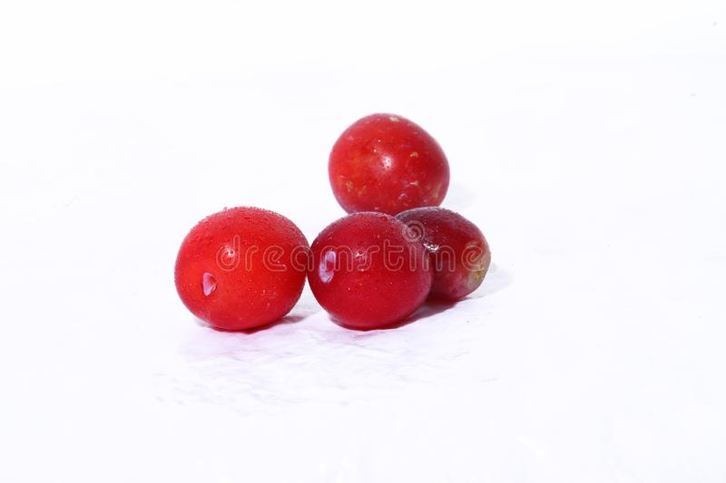 Red cherry plum. Fresh red cherry plum on white background. water sprayed over fruits stock photo