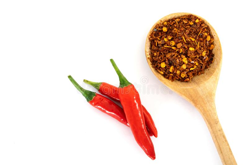 Fresh red chilli pepper and crushed dried red cayenne pepper wit royalty free stock images