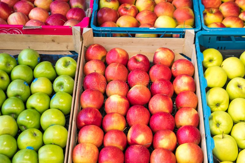 Fresh red and green apples in a market stock images