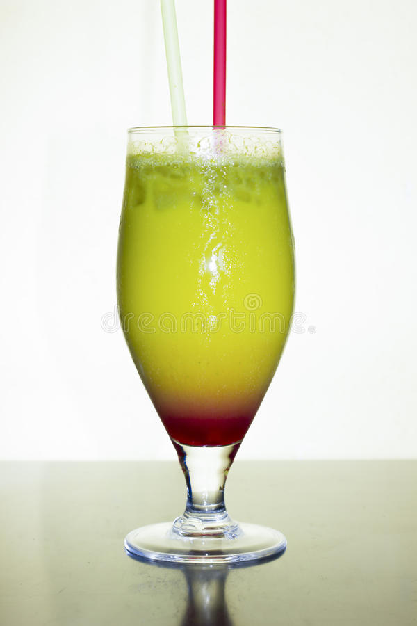 The Blue cocktail recipe is a blue colored drink made from Silver tequila, blue curacao, lemon-lime soda and sweet and sour mix, and served in a chilled cocktail glass garnished with an orange twist.