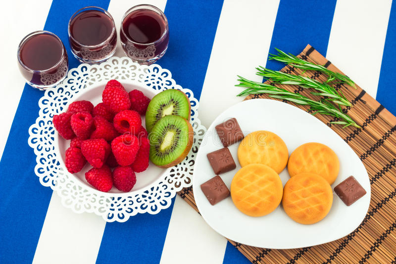 Fresh Red Raspberries on a white artistic plate stock photo