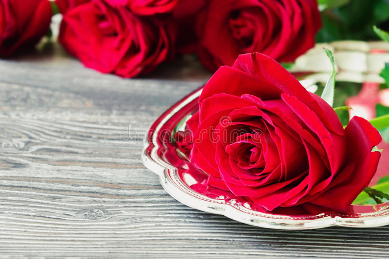Fresh red roses. On a tray on dark wooden background. festivals and events. valentine's day, mother's day royalty free stock photo