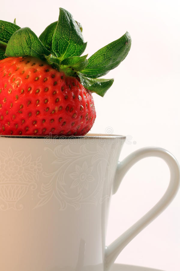 Download Fresh Red Strawberries Inside A White China Teacup Stock Photo - Image of health, green: 24550956