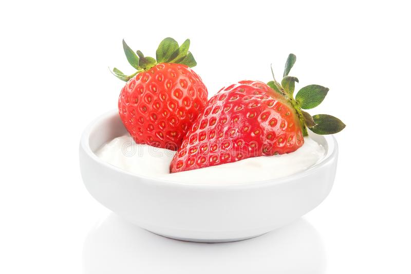 Fresh red strawberry in bowl with tasty sour cream royalty free stock image
