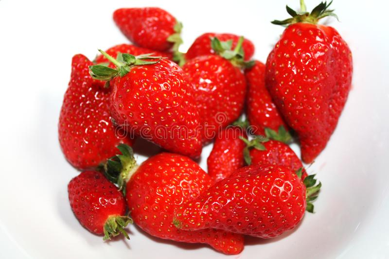 Fresh strawberries isolated on the white plate. royalty free stock photography