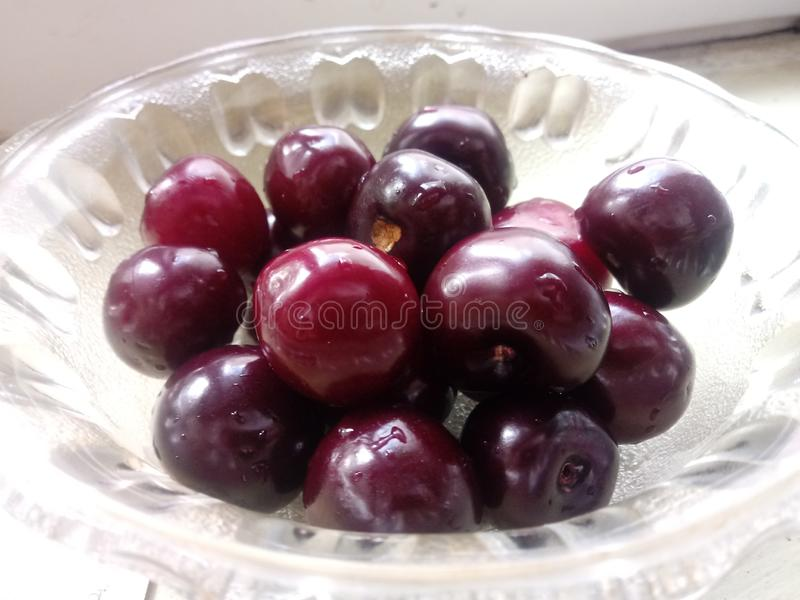 Fresh red sweet cherries in a bowl. stock photography