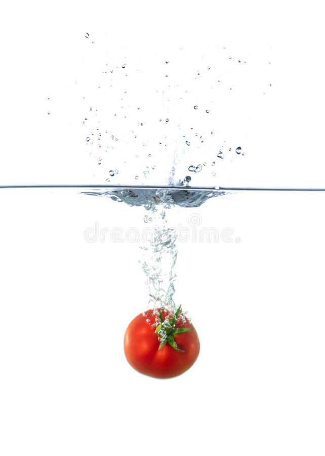 Fresh Red Tomato Sinking in Water stock image