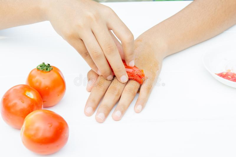 Fresh red tomatoes and skin mask. royalty free stock photos