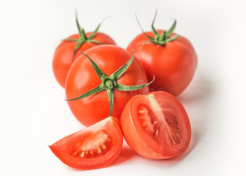 Fresh red tomatoes on white isolated background. Fresh red tomatoes on , white isolated background stock photos