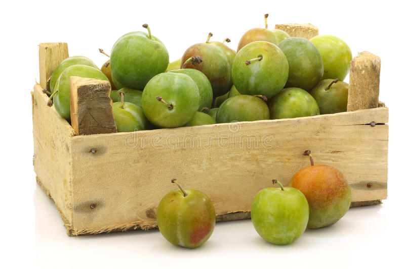 Fresh Reine Claude plums in a wooden crate