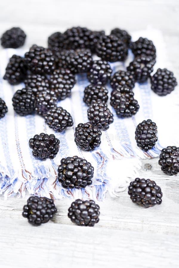Fresh ripe blackberries on cloth napkin close up stock photography