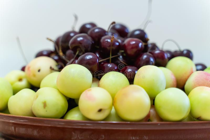 fresh ripe cherries and apricots closeup as background. beautiful fruit background royalty free stock photography